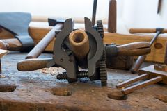 Old carpentry workshop. The clamping mechanism on the table in a carpentry workshop. Old carpentry workshop with obsolete tools used. Vintage woodworking hand Stock Photo