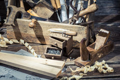 Old carpentry workshop with toolbox. On old wooden table Stock Photo