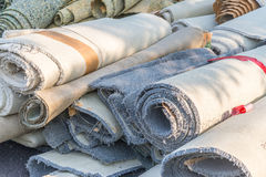 Old carpet rolls Stock Photos
