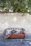Old carpet on sofa bed Royalty Free Stock Photo