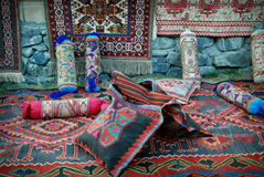 Old carpets, rugs and pillows Stock Photo