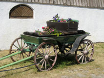 Old carriage. With the flower boxes Stock Photography