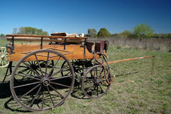 Old carriage. Old wooden carriage in the countryside Royalty Free Stock Image