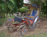 Old carriage in an abandoned garden.Thailand. 2017 Stock Image