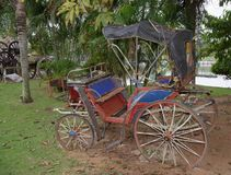 Old carriage in an abandoned garden.Thailand. 2017 Royalty Free Stock Photos