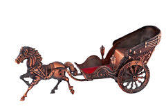 An old carriage copper built miniature. A copper miniature carriage which was used as a toy for children from the last century stock photos
