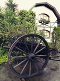 Old carriage in garden. With a country house background Stock Photo