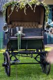 Old carriage in a meadow royalty free stock image