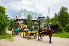 Old carriage in russian tourist center Verhnie Mandrogi Stock Photo