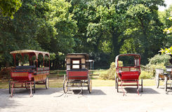 Old carriages in village, France Stock Images