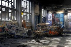 Old cars in an abandoned hall Stock Image