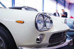 Old cars auction - People viewing cars on sale Stock Image
