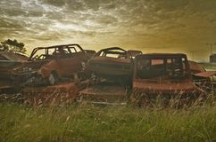 Old cars corroded on junkyard. The old ruined cars that were corroded thrown into junkyard royalty free stock photos