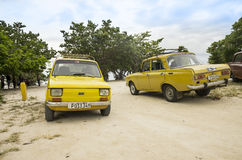Old cars on Cuban beach Royalty Free Stock Image