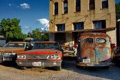 Vintage cars in Texas. Vintage cars parked outside a historic building in the city of Granger, Texas, U.S.A Royalty Free Stock Image