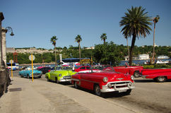 Old cars in Havana Cuba. HAVANA/CUBA - 30 NOVEMBER 2015 - old cabrio taxis waiting for customers on the 30th of November 2015 in Havana, Cuba Stock Image