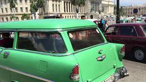 Old cars in Havana Vieja and the Capitolio, Cuba.  stock video