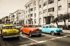 Old cars. Incredible three old cars. Blue, red and yellow car stock photography