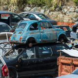 Old cars in the junkyard. Cars that have finished their lives, are now massed for possible recycling in whole or in part of them Royalty Free Stock Images