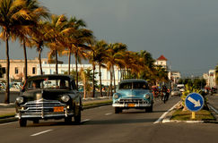 Old cars on malecon in Cienfuegos, Cuba royalty free stock photo