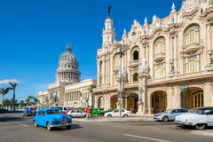 Old cars next to the Great Theater of Havana and the Capitol. HAVANA,CUBA - JULY 14,2016 : Street scene with old cars next to the Great Theater of Havana and the royalty free stock photo