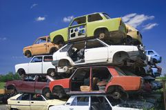 Old cars pyramid. Pyramid of rusty colorful cars Royalty Free Stock Photos