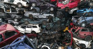 Old cars stacked in scrapyard.
