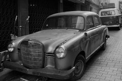 Old cars on street. Parked, crushed, damaged Royalty Free Stock Photography