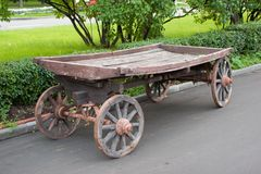 Old cart. Old country cart in a garden Stock Image