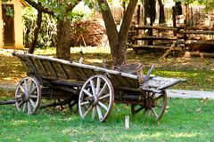 Old cart. The old cart with a wicker basket stands on a farm Stock Images