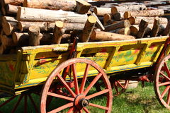 Old cart. With cut trees Royalty Free Stock Photography