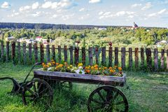 The old cart as a landscape gardening object stock photos