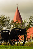 Old cart in front of typical Icelandic church at Glaumbaer farm Stock Image