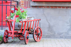 Old cart with geranium Royalty Free Stock Photos