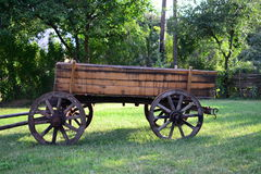 Old cart. On grass with trees Stock Photos