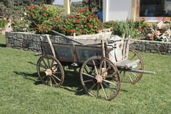 an old cart in the interior of the site near the house Royalty Free Stock Photo
