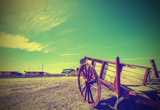 Old cart left on deserted road in Patagonia, retro style. Royalty Free Stock Image