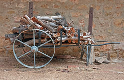 Old cart with logs Royalty Free Stock Photos