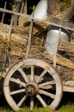 Old cart of the milk with straw Stock Images