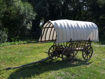 Old cart with tarpaulin Royalty Free Stock Photo