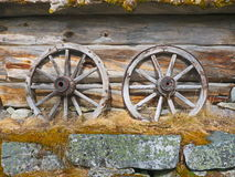 Old cart wheels. At an old barn wall Stock Photography