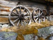 Old cart wheels. At an old barn wall Royalty Free Stock Photo