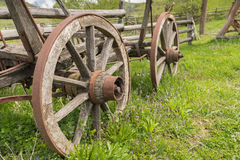 Old Cart wheels. In a grassy yard Stock Photo