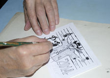 The old cartoonist hands drawing Royalty Free Stock Image