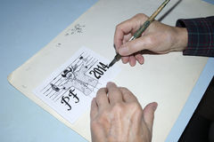 The old cartoonist hands drawing Royalty Free Stock Photo