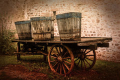 Old carts. Wall, antique vehicle Stock Images