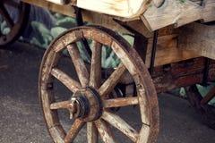 Old cartwheel of horse drawn wooden cart.  Stock Photo