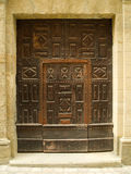 Old carved door in stone wall. Old carved door with stone surround Royalty Free Stock Photos