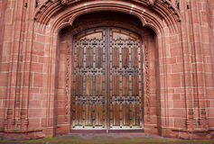 Old carved entrance door to Cathedral Stock Image