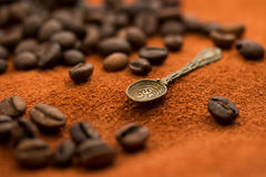 Old carved spoon and coffee beans Stock Photo